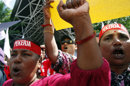 Workers chant slogans during a May Day rally to call for a minimum wage law in Kuala Lumpur, Malaysia, Tuesday, May 1, 2012. (AP Photo/Lai Seng Sin)