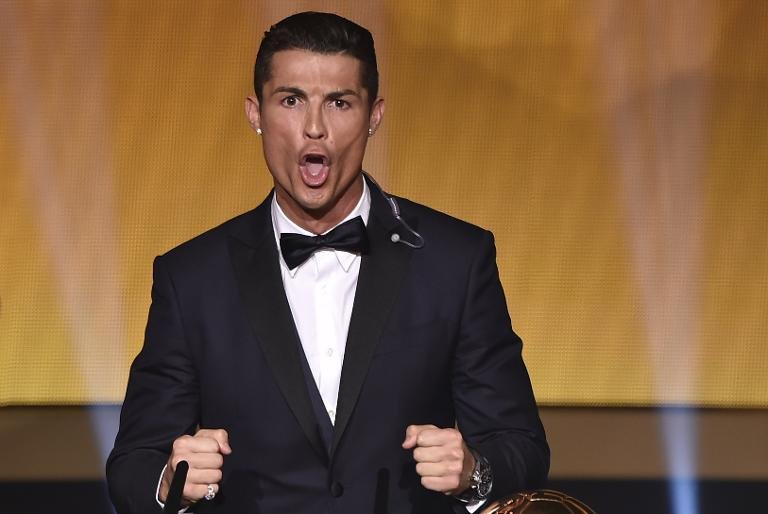 Real Madrid and Portugal forward Cristiano Ronaldo reacts after receiving the 2014 FIFA Ballon d'Or award for player of the year during the award ceremony at the Kongresshaus in Zurich on January 12, 2015