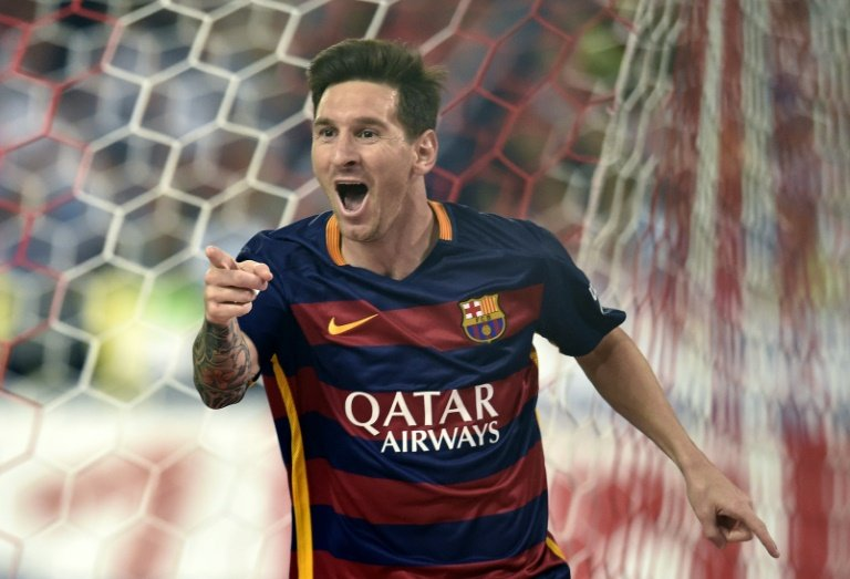 Barcelona's Argentinian forward Lionel Messi celebrates after scoring during the Spanish league football match Club Atletico de Madrid vs FC Barcelona at the Vicente Calderon stadium in Madrid on September 12, 2015