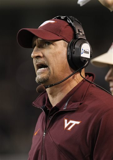 FILE - In this Oct. 15, 2011, file photo, Virginia Tech defensive coordinator Bud Foster against Wake Forest during the second half of an NCAA college football game in Winston-Salem, N.C. Foster found out quickly that just because his players have extra cash in the form of stipends, it does not mean he can fine them when they screw up. Coaches cannot take away scholarship money, but they can withhold things like tickets, bowl gifts and per diems. (AP Photo/Bob Leverone, File)