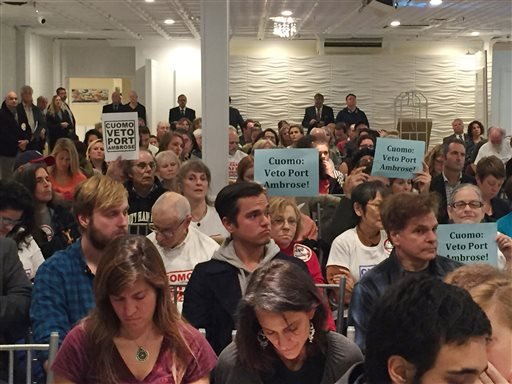 In this Nov. 2, 2015 photo, signs opposing a proposed offshore liquefied natural gas pipeline can be seen in the crowd during a meeting at the Long Beach Hotel in Long Beach, N.Y. Liberty Natural Gas LLC wants to build an offshore gas terminal in the waters between New York and New Jersey that will pump liquefied gas through a subsea pipeline into an existing pipeline running between the two states. (AP Photo/Michael Balsamo)
