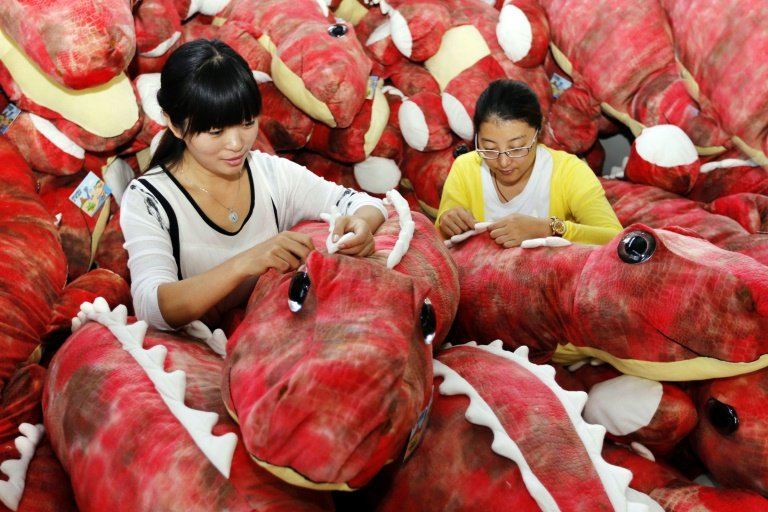 Workers make soft toys at a factory in Lianyungang, China's Jiangsu province, on September 6, 2015
