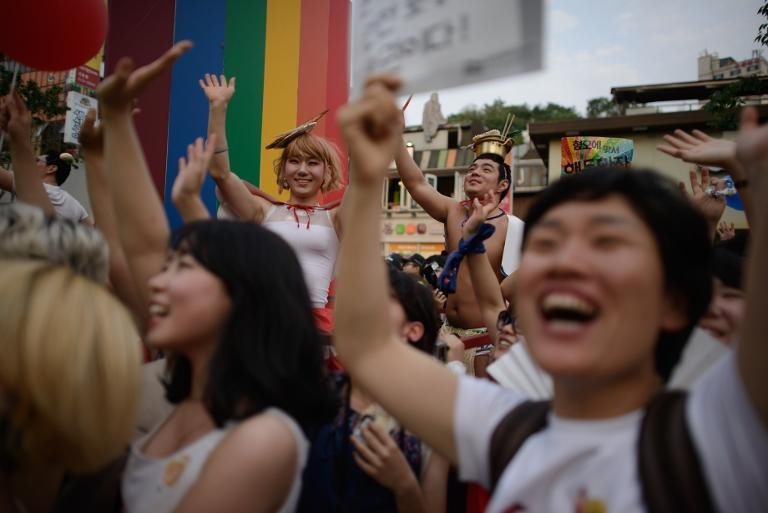 Members of the LGBT community take part in a Gay Pride parade in Seoul on June 7, 2014