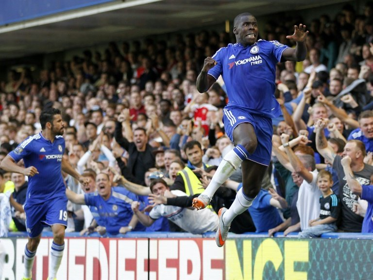 Chelsea's defender Kurt Zouma (R) celebrates after scoring the opening goal of an English Premier League football match against Arsenal at Stamford Bridge in London on September 19, 2015