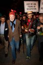 FILE - In this Oct. 21, 2011 file photo, activist musician Pete Seeger, 92, left, marches with his grandson Tao Rodriguez-Seeger, right, and nearly a thousand demonstrators sympathetic to the Occupy Wall Street protests for a brief acoustic concert in Columbus Circle, in New York. The demonstrators marched down Broadway singing 'This Little Light of Mine' and other folk and gospel songs while ad-libbing lines about corporate greed and social justice. (AP Photo/John Minchillo, File)