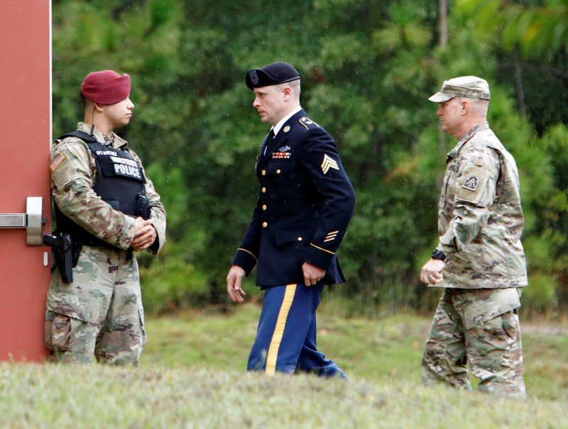 Sgt. Robert B. Bergdahl (C) is escorted into the court house after a lunch break during his hearing in the case of United States vs. Bergdahl in Fort Bragg, North Carolina, U.S., October 16, 2017.  REUTERS/Jonathan Drake/File Photo