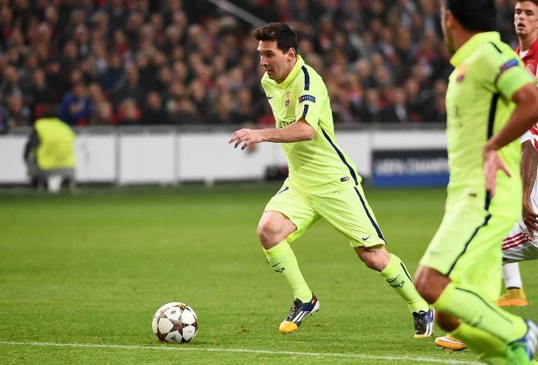 Barcelona's Argentinian forward Lionel Messi controls the ball during the UEFA Champions League football match between Ajax Amsterdam and FC Barcelona in Amsterdam, on November 5, 2014