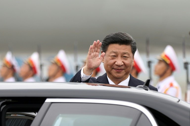 China's President Xi Jinping waves as he arrives at Noi Bai International airport in Hanoi, on November 5, 2015