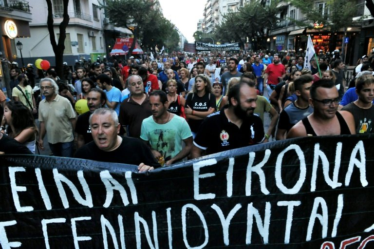 Demonstrators take part in a protest against government austerity measures and reforms of the third Greek bailout at the annual Thessaloniki International Fair (TIF) in Thessaloniki on 5 September, 2015