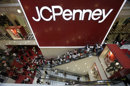 FILE - This July 31, 2009 file photo shows the main entrance of a J.C. Penney store in the Manhattan Mall in New York. J.C. Penney Co. is expected to report its earnings late Tuesday, May 15, 2012. (AP Photo/Mary Altaffer, File)