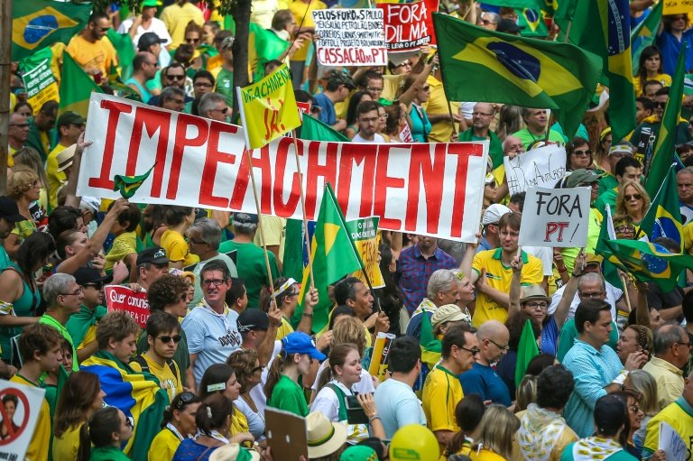 Demonstrators take part in a protest against the government of President Dilma Rousseff in Porto Alegre, Brazil on April 12, 2015