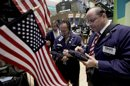 FILE- In this Monday, June 11, 2012, file photo, traders Stephen Kaplan, center, and Jeffrey Vazquez, right, work on the floor of the New York Stock Exchange. U.S. stocks were poised to fall Wednesday June 13, 2012. Dow futures lost 0.1 percent to 12,500.00 while broader S&amp;P 500 futures dropped 0.2 percent to 1,317.70. (AP Photo/Richard Drew, FIle)