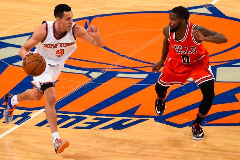 Pablo Prigioni of the New York Knicks attempts to dribble past Aaron Brooks of the Chicago Bulls during their game at Madison Square Garden on October 29, 2014
