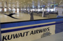 View of empty Kuwait Airways check-in counters at Kuwait Airport on Sunday, March 18, 2012. Kuwait Airways, the Gulf state's national carrier, extended flight cancellations across its route network into a second day Sunday as it scrambled to cope with a strike by workers. The action by Kuwait Airways employees follows a work stoppage by customs officials that began last week and is blocking food items from entering the country. Workers are demanding higher pay and other benefits. (AP Photo/Gustavo Ferrari)