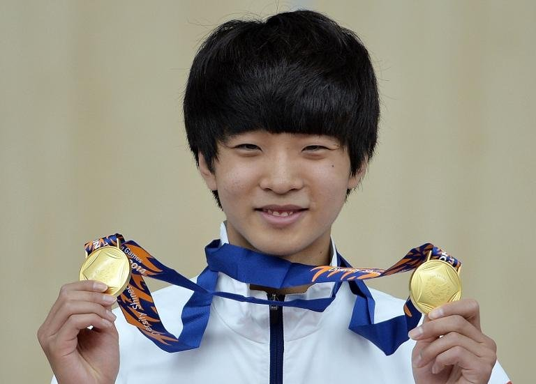 Kim Cheong-Yong of South Korea poses with his medals on the podium after winning the men's 10m air pistol individual and team final of the 2014 Asian Games, at the Ongnyeon International shooting range in Incheon, on September 21, 2014
