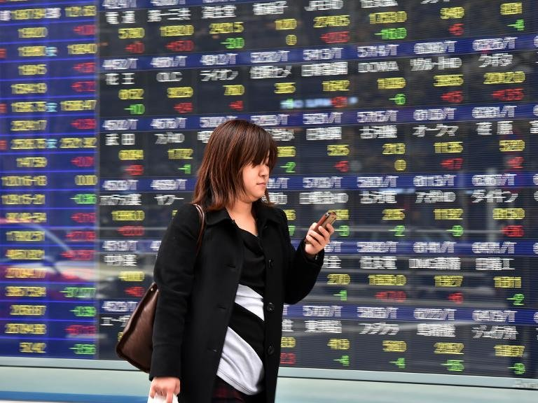 Tokyo stocks closed down 0.15 percent Friday after the benchmark Nikkei index briefly broke through the 20,000 level