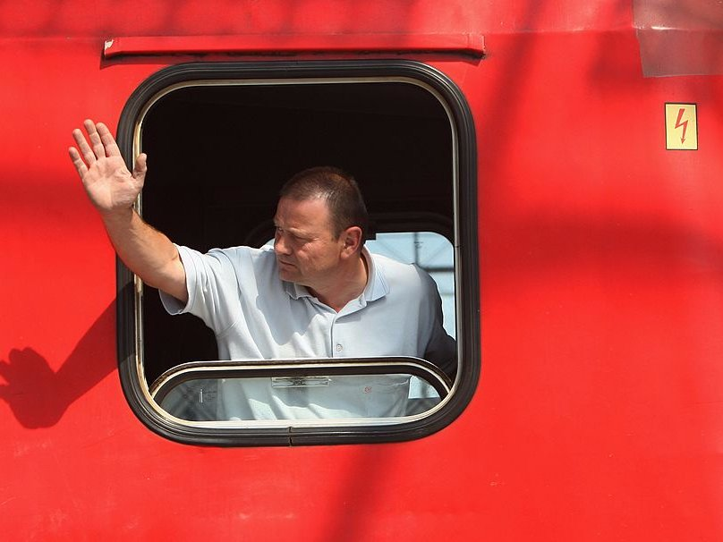 train driver waving