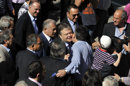 Leader of the Greek Socialist PASOK party Evangelos Venizelos, center, is greeted by supporters upon his arrival outside a polling station in Thessaloniki, northern Greece Sunday May 6, 2012. Greeks cast ballots on Sunday in their most critical _ and uncertain _ election in decades, with voters set to punish the two main parties that are being held responsible for the country&#039;s dire economic straits. (AP Photo/Nikolas Giakoumidis)