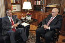 "Greek President Karolos Papoulias, right, meets with Greek conservative leader Antonis Samaras before giving him a mandate to form a government in Athens, Monday, June 18, 2012. Samaras, who came first in Sunday's national election, says he will meet with leaders of all parties ""that believe in Greece's European orientation and the euro"" this afternoon in order to form a new coalition government. (AP Photo/Yorgos Karahalis, Pool)"