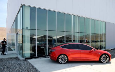 FILE PHOTO - A prototype of the Tesla Model 3 is on display in front of the factory during a media tour of the Tesla Gigafactory which will produce batteries for the electric carmaker in Sparks, Nevada, U.S. July 26, 2016.  REUTERS/James Glover II/File Photo