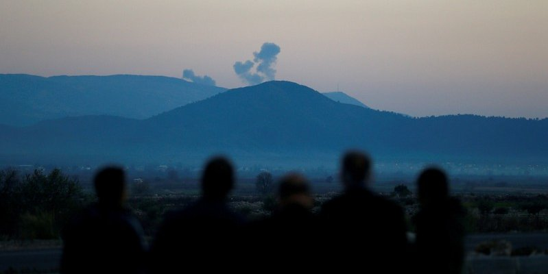 Smoke rises from the Syria's Afrin region, as it is pictured from near the Turkish town of Hassa, on the Turkish-Syrian border in Hatay province, Turkey January 20, 2018. REUTERS/Osman Orsal/File Photo