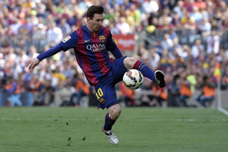 Barcelona's Argentinian forward Lionel Messi controls a ball during the Spanish league football match FC Barcelona v Valencia CFat the Camp Nou stadium in Barcelona on April 18, 2015