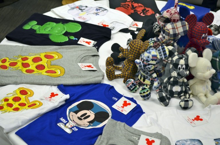 T-shirts featuring Disney's Mickey Mouse, sold in Uniqlo stores, are showcased during press day on August 13, 2015 in Los Angeles, California