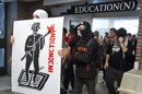 Protesters make their way through the hall of a Montreal university to disrupt classes Wednesday, May 16, 2012 in Montreal. Carrying a list of scheduled classes, about 100 hard-core protesters marched through pavilions at the Universite du Quebec a Montreal. The student unrest has lasted 14 weeks. Only one-third of Quebec students are actually on declared strikes, but the conflict has created considerable social disorder. (AP Photo/The Canadian Press, Paul Chiasson)