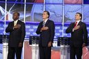 FILE - In this Oct. 18, 2011, file photo, Republican presidential candidates Herman Cain, left, former Massachusetts Gov. Mitt Romney, center, and Texas Gov. Rick Perry are seen before a Republican presidential debate in Las Vegas. Key proposals from the Republican presidential candidates might make for good campaign fodder. But independent analyses raise serious questions about those plans and their ability to cure the nation's economic and housing woes. The candidates are pushing lower taxes and less regulation in the name of job creation. But employers say poor consumer demand is a far bigger obstacle to new hires. (AP Photo/Isaac Brekken, File)