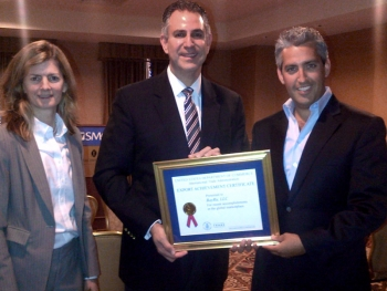Under Secretary Francisco Sanchez and Chicago U.S. Export Assistance Center Director Julie Carducci present Export Achievement Certificate to BayRu CEO Aaron Block. (Photo Commerce)