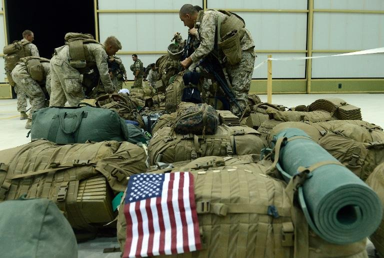 US Marines arrive in Kandahar after their withdrawl from the Camp Bastion-Leatherneck complex in Helmand province on October 26, 2014