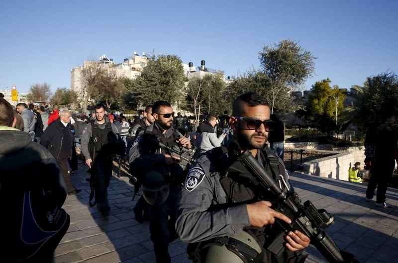 Israeli policemen patrol an area near the scene where three Palestinians were shot dead by Israeli police after carrying out what Israeli police spokesman said was a shooting and stabbing attack outside Damascus Gate to Jerusalem's Old City, in this February 3, 2016 file picture. REUTERS/Ronen Zvulun/Files