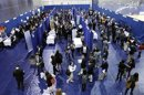 American University students walk among recruiting booths during a career job fair at American University in Washington