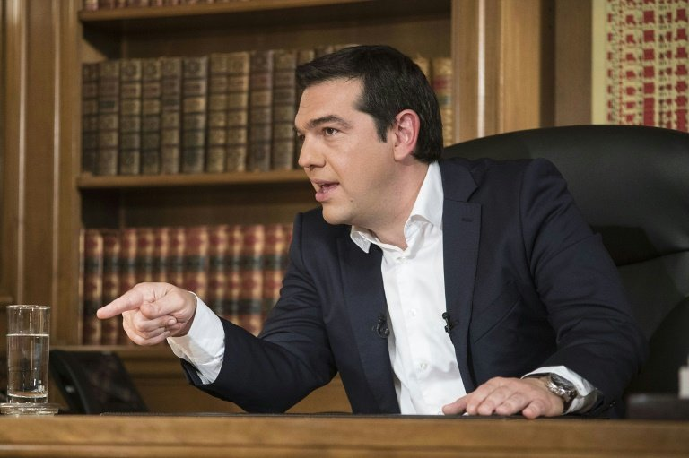 Greece's Prime Minister Alexis Tsipras, pictured here in his office in July, is facing a major revolt in his Syriza party with members opposed to the third bailout deal