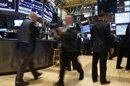 Trading specialists hurry around on the floor of the New York Stock Exchange