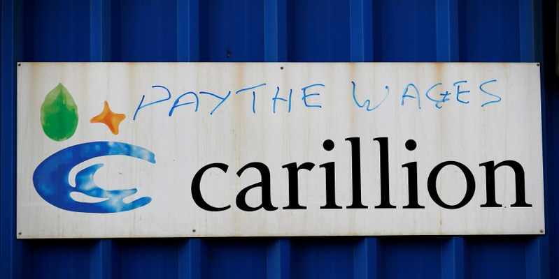Defaced branding is seen outside Carillion's Royal Liverpool Hospital site in Liverpool, Britain, January 16, 2018. REUTERS/Phil Noble